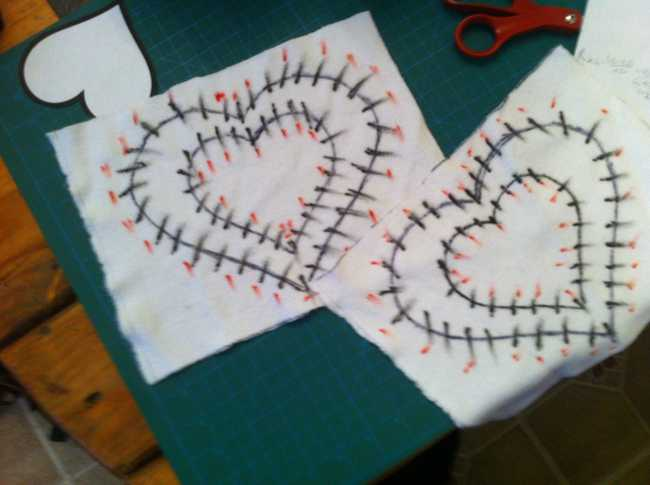 Heart LED stensils drawn on paper with red markings for LED positions